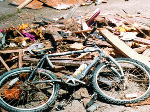 Bicycle in flood debris collected at Street Facility after the Spring Creek Flood